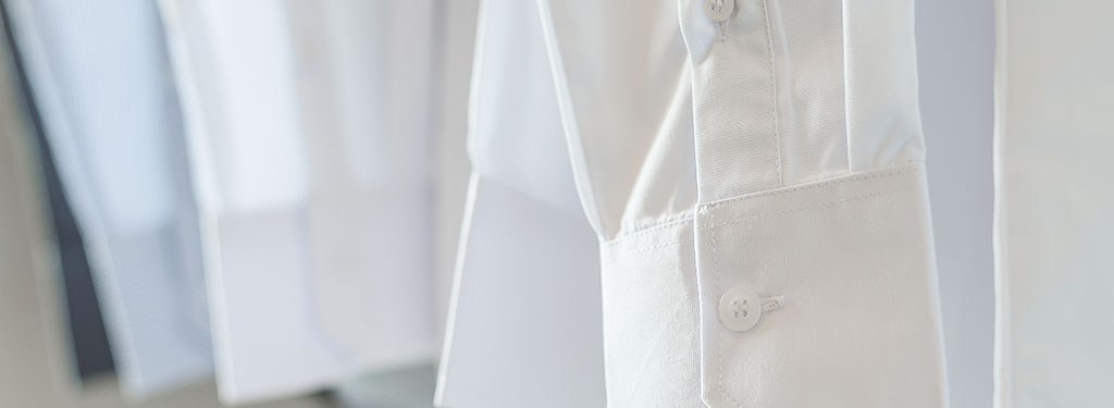 Close-up of white dress shirt cuff after using Woolite<sup>®</sup> Wrinkle & Static Remover