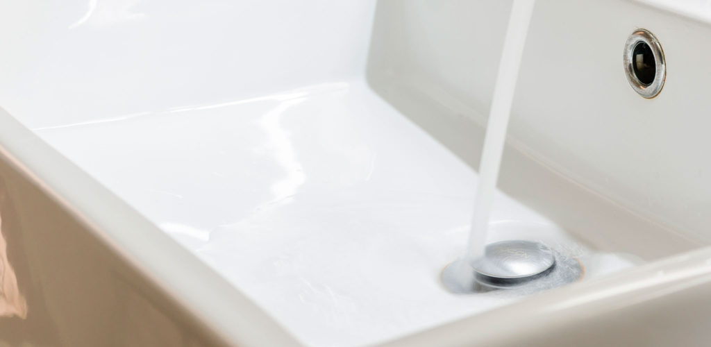White Sink with Water Running